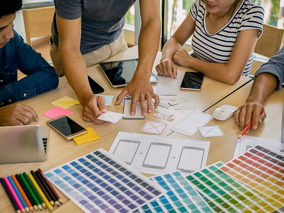 Work Group Chooses Between Colors to Use for Company Logo Image