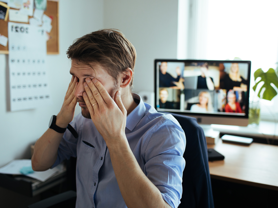 Man Rubs Eyes After Staring at Computer for a Long Time